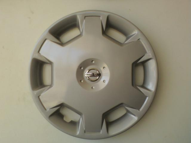 87 Stanza hubcaps